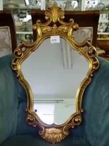 Auksinis veidrodis storesniais rėmais